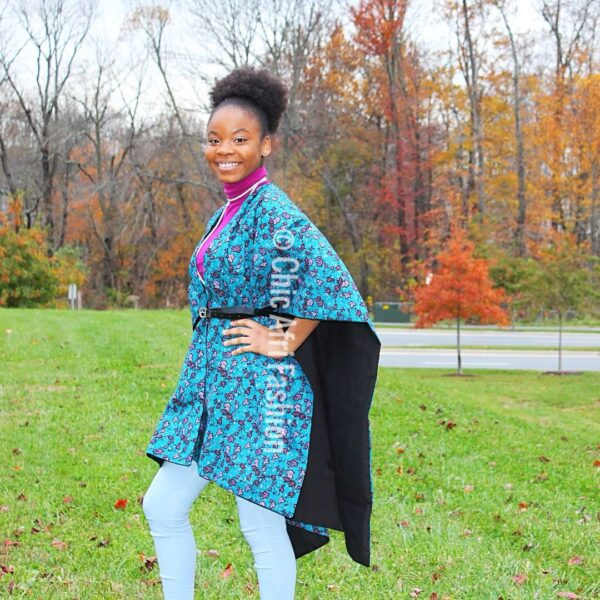 Woman Smiling earing purple poncho made of African Prints Fabric