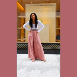 Woman wearing pink wide leg pants