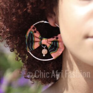 Woman left side wearing earrings made of african prints fabric