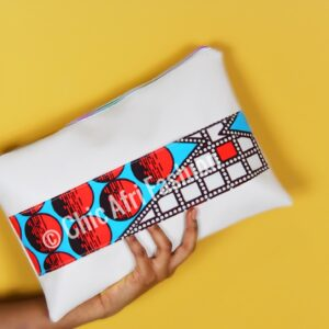 Cream Faux leather clutch held in a hand