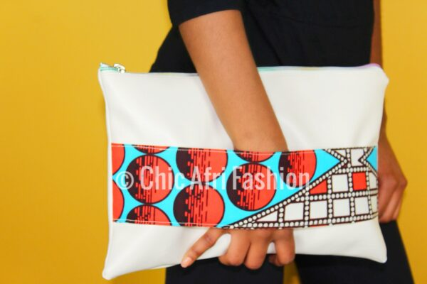 Woman holding a clutch bag with focus on the clutch