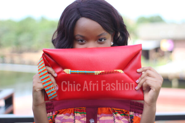 Red Faux Leather Clutch bag held by a black woman