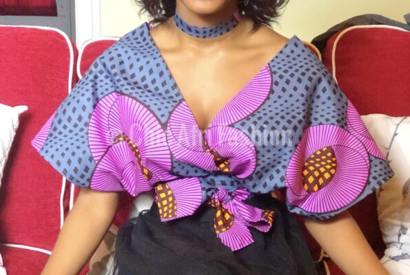 Woman's upper body wearing a grey and purple African Fabric Top