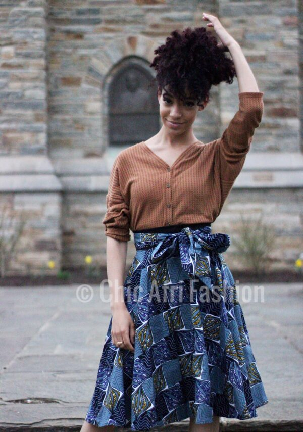 Woman with curly hair Wearing Blue African Prints Skirt