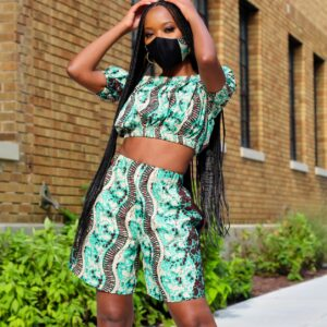 Woman Wearing a crop Top and Shorts made from Green African Print Fabric