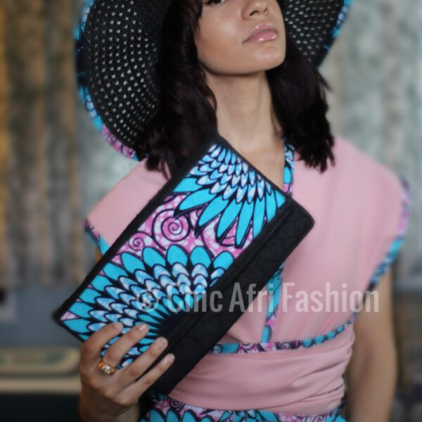 Woman holding a denim clutch made of African Prints