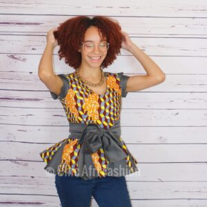 Woman playing with her hair smiling and wearing African Prints Top