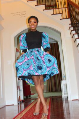 Woman Smiling Wearing African Print Skirt and Ankara Top