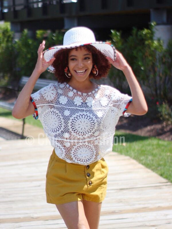 Happy Black Woman Smiling and wearing a hat