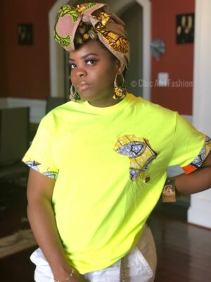 Black Woman Wearing Neon Green Tee shirt With Africa and Madagascar Map graphic