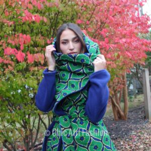 Woman Wearing A green Coat made of green African Fabric
