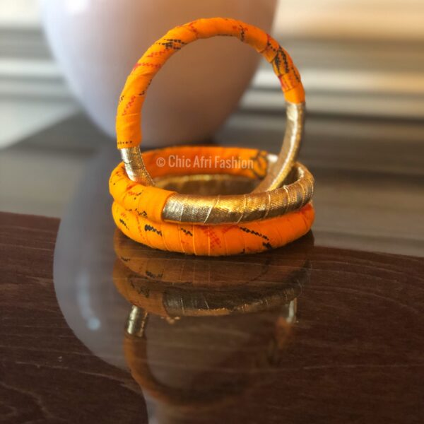 Orange and gold Bangles stacked